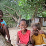 Ni-vanuatu children posing outside their home pre-cyclone